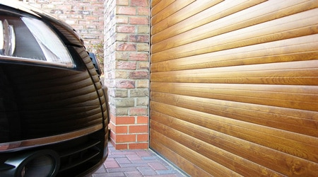 prix d 39 une porte de garage enroulable co t moyen tarif de pose. Black Bedroom Furniture Sets. Home Design Ideas