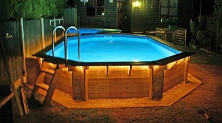 Prix d 39 une piscine en bois co t moyen tarif d 39 installation - Prix moyen piscine coque ...