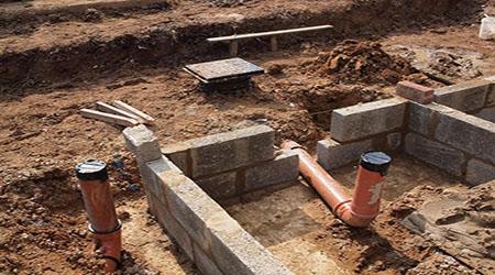 La pose des fondations d'une maison