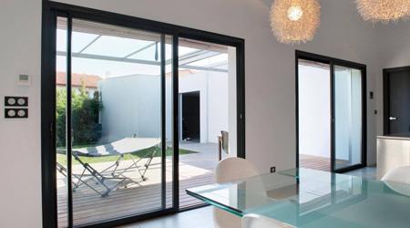prix d 39 une baie vitr e coulissante co t moyen tarif de pose. Black Bedroom Furniture Sets. Home Design Ideas