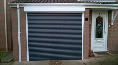 Prix d 39 une porte de garage enroulable co t moyen tarif for Volet de garage enroulable