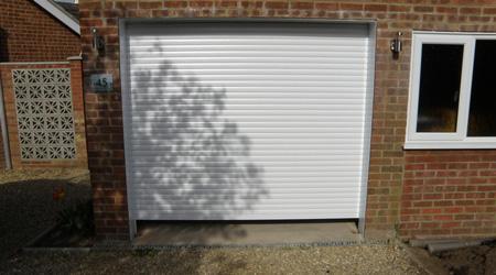 Prix d'une porte de garage enroulable motorisée