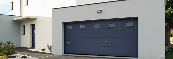 Prix d 39 une porte de garage avec portillon co t moyen for Cout porte garage