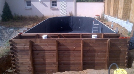 Prix d 39 une piscine en bois co t moyen tarif d 39 installation for Tarif piscine enterree